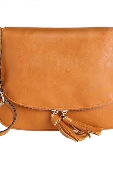 Leather Saddle Shoulder Bag Featuring Zipper and Tassel Detailing